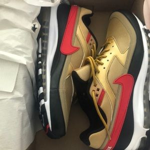 Brand new, never worn gold and red Nike Air Max